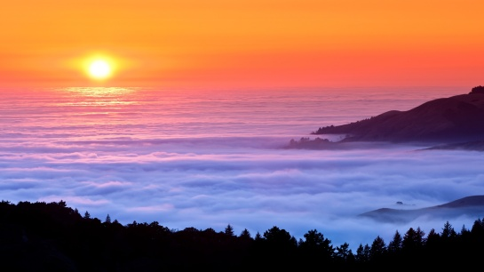 sunset-fog-over-sea-mountains-2560x1440